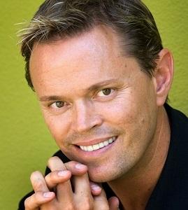 Headshot of Lifetime Arts Trainer, Dane Stauffer.